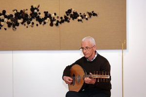 Tim Barrie performing on the horse hair oud made for Cat Auburn's exhibition The Horse Stayed Behind.