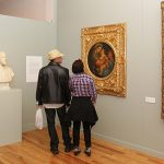 Visitors viewing the exhibition Curiosities